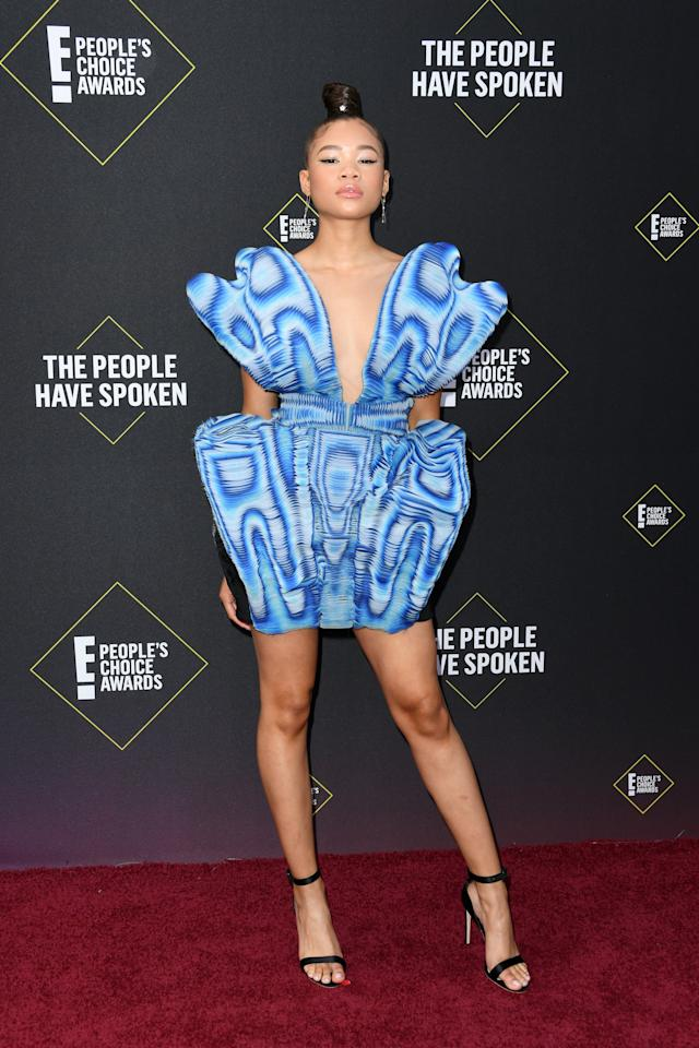 "<p><strong>Euphoria</strong> star <a href=""https://www.popsugar.com/fashion/storm-reid-blue-dress-at-peoples-choice-awards-2019-46879866"" class=""ga-track"" data-ga-category=""Related"" data-ga-label=""https://www.popsugar.com/fashion/storm-reid-blue-dress-at-peoples-choice-awards-2019-46879866"" data-ga-action=""In-Line Links"">Storm Reid looked absolutely eye-catching in an Iris van Herpen blue dress and black Sophia Webster heels</a>.</p>"