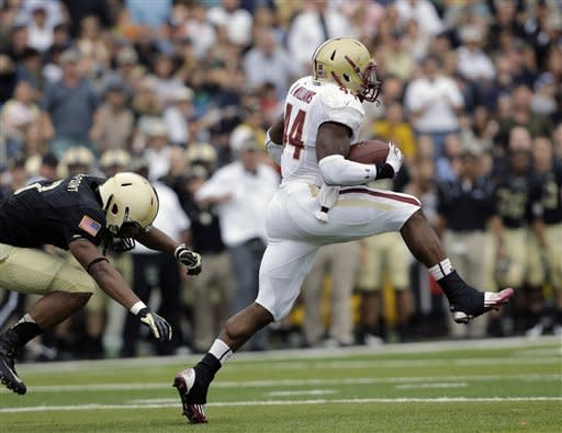 Boston College running back Andre Williams (44) breaks away from Army defensive back Chris Carnegie (3) for a 99-yard touchdown run during the first half of an NCAA college football game Saturday, Oct. 6, 2012, in West Point, N.Y. (AP Photo/Mike Groll)