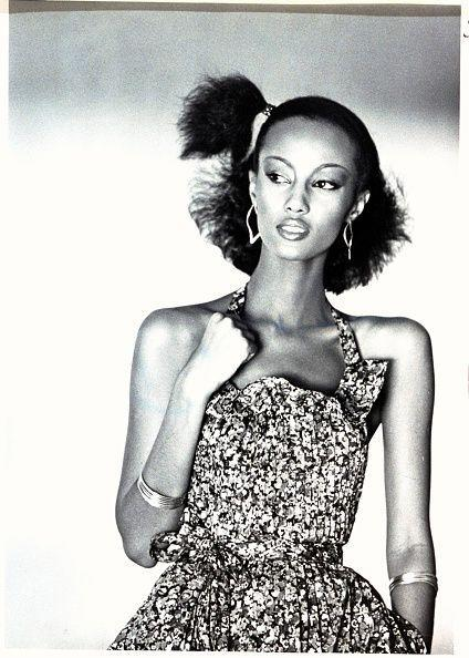 <p>Fashion model Iman wears her short hair in a half up, half down side pony during a fashion shoot in 1977. </p>