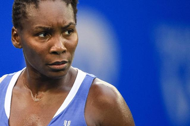 Venus Williams of US prepares to serve on October 2, 2015 (AFP Photo/Fred Dufour)