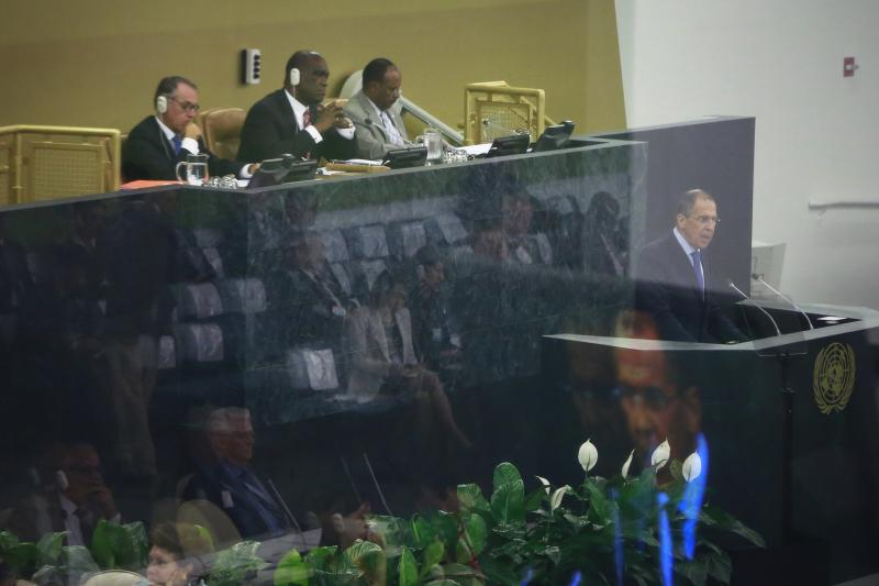 Russia's Minister of Foreign Affairs Sergey Lavrov (R) is reflected on a screen as he speaks during the 68th session of the United Nations General Assembly at the U.N. headquarters in New York September 27, 2013. REUTERS/Shannon Stapleton (UNITED STATES - Tags: POLITICS)