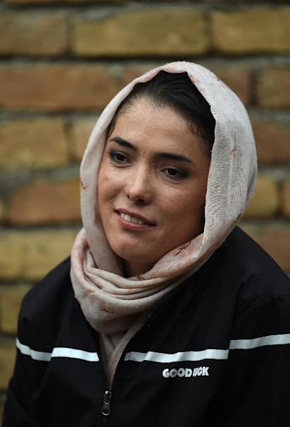Cyclist Kobra Samim took part in the #MyRedLine campaign that aims to protect women's hard-won advancements in Afghanistan (AFP Photo/WAKIL KOHSAR)
