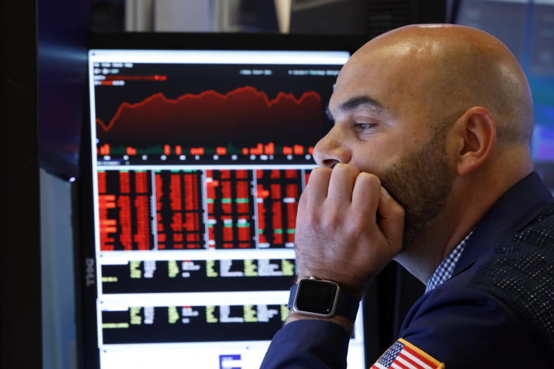 "Trader Fred DeMarco works on the floor of the New York Stock Exchange, Friday, Aug. 23, 2019. Stocks tumbled on Wall Street after President Donald Trump said he ""hereby ordered"" U.S. companies to consider alternatives to doing business in China. (AP Photo/Richard Drew)"