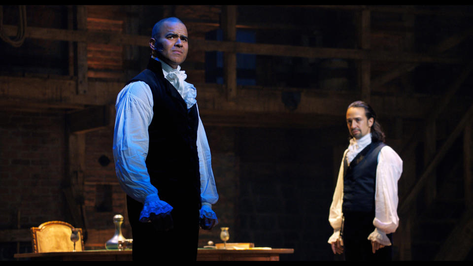 """In this image released by Disney Plus, Chris Jackson portrays George Washington, left, and Lin-Manuel Miranda portrays Alexander Hamilton in a filmed version of the original Broadway production of """"Hamilton."""" (Disney Plus via AP)"""