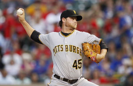 FILE PHOTO: Pittsburgh Pirates starting pitcher Gerrit Cole pitches against the Texas Rangers in the first inning of their MLB interleague baseball game in Arlington, Texas September 9, 2013. REUTERS/Mike Stone
