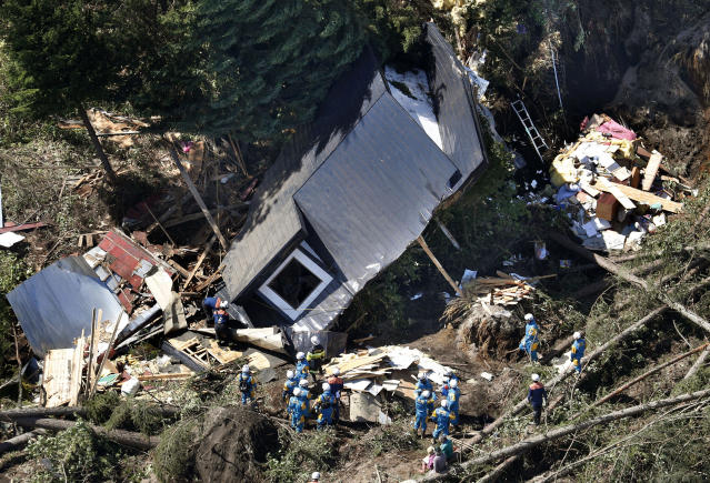 <p>Police search missing persons around houses destroyed by a landslide after an earthquake in Atsuma town, Hokkaido, northern Japan, Thursday, September 6, 2018. A powerful earthquake rocked Japan's northernmost main island of Hokkaido early Thursday, triggering landslides that crushed homes, knocking out power across the island, and forcing a nuclear power plant to switch to a backup generator. (Kyodo News via AP) </p>