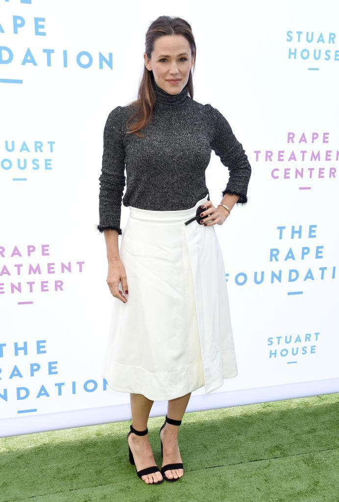 <p>On October 7, Jennifer Garner attended The Rape Foundation's annual brunch in an autumn-ready knit and midi skirt. <em>[Photo: Getty]</em> </p>
