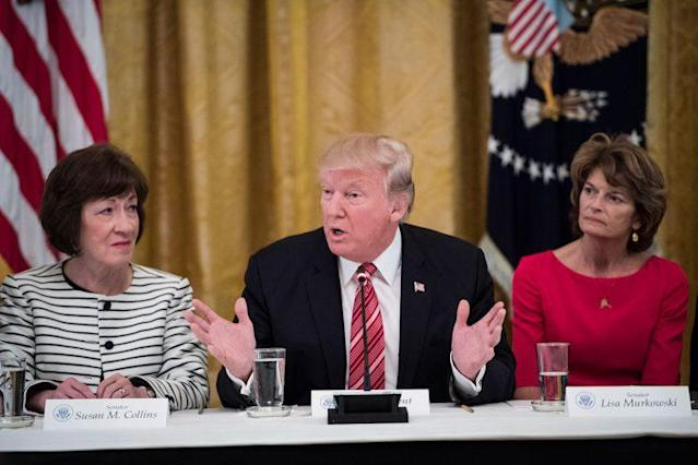 "President Trump is flanked by Sen. Susan Collins, R-Maine, and Sen. Lisa Murkowski, R-Alaska. Both women held fast in their rejection of the ""skinny repeal"" of the ACA. (Photo: Getty Images)"