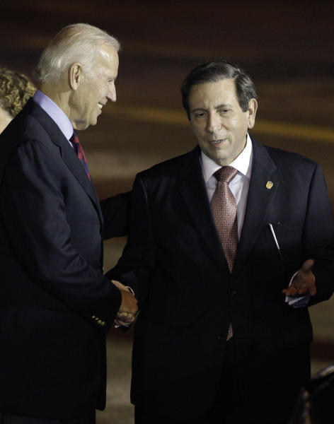 U.S. Vice President Joe Biden, left, shakes hands with Panamanian Foreign Minister Fernando Nunez Fabrega during a welcoming ceremony at the Tocumen International Airport in Panama City, Monday, Nov. 18, 2013. Biden arrived in Panama for a two-day official visit. (AP Photo/Arnulfo Franco)