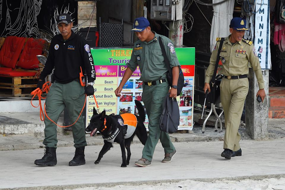 A police dog team leaves to continue the search for missing British tourist Amelia Bambridge on Koh Rong island in Sihanoukville province on October 31, 2019. - The family of the 21-year-old British tourist who went missing on a Cambodian island a week ago continued a meticulous search around the waters and dense jungle territory. (Photo by TANG CHHIN Sothy / AFP) (Photo by TANG CHHIN SOTHY/AFP via Getty Images)