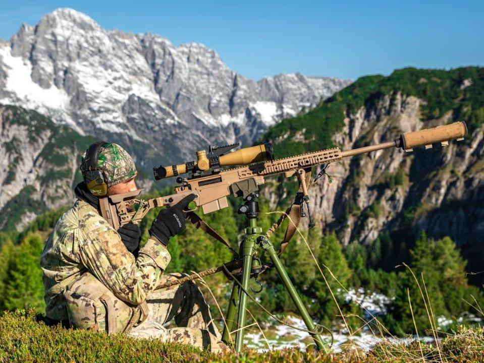 An Italian Special Forces Sniper engages targets