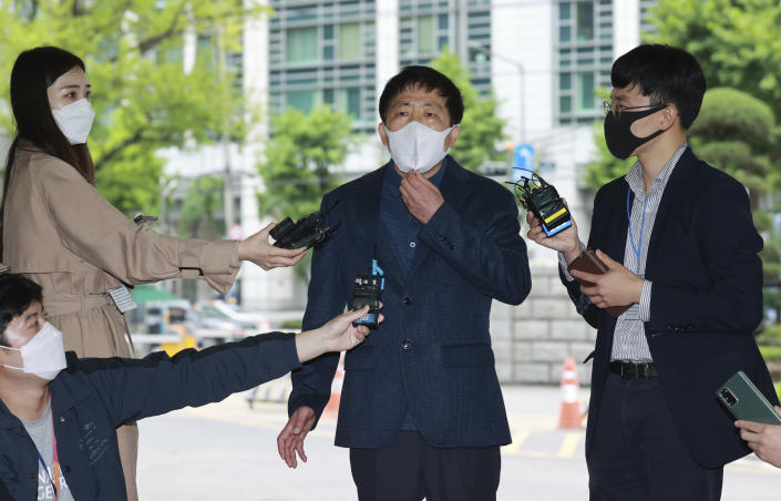 Park Sang-hak, center, speaks to the media upon his arrival at the Seoul Metropolitan Police Agency in Seoul, South Korea, Monday, May 10, 2021. South Korean police in Monday summoned the activist who said he flew hundreds of thousands of anti-Pyongyang propaganda leaflets toward North Korea in defiance of a new controversial law that criminalizes such activities. (Hong Hye-in/Yonhap via AP)
