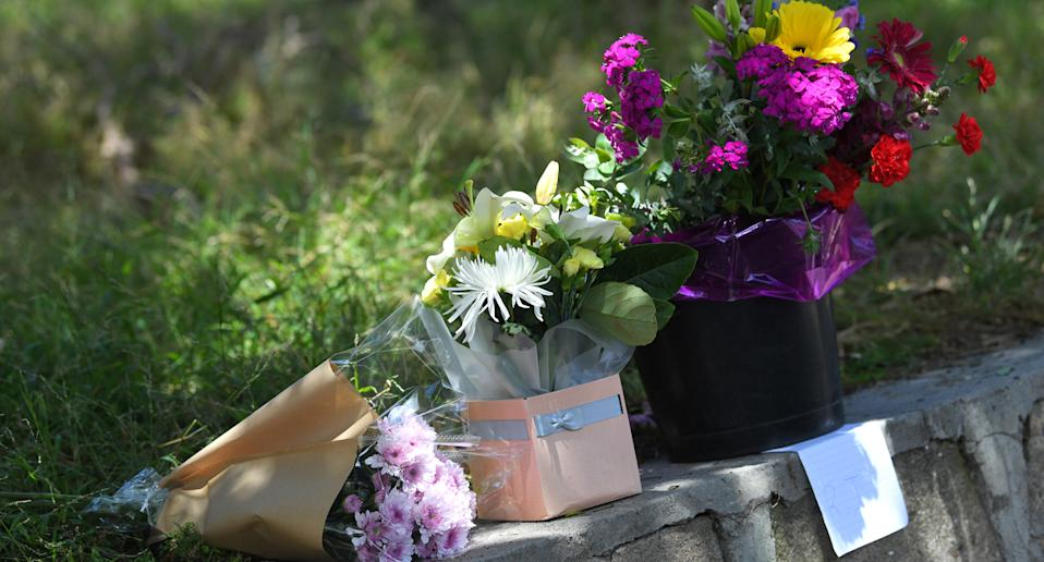 Floral tributes left near Seaford train station where tradie Cam Smith was stabbed.