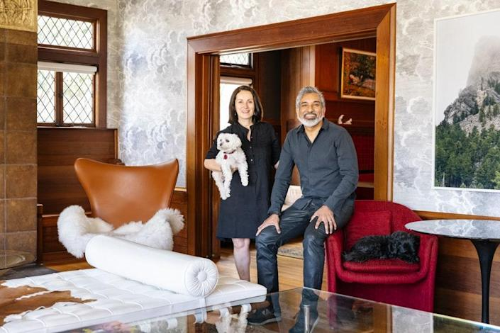 Maria Alataris, Vishaan Chakrabarti, and their two dogs, Hero and Rosie, in the living room of their new 1925-built home in Berkeley, California, where Chakrabarti now serves as the new dean of U.C. Berkeley's College of Environmental Design.