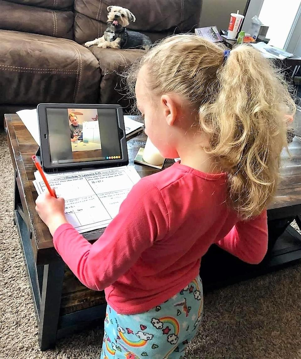 Kenzie Roach, a student at Conesville Elementary School in Ohio, works on a lesson with a teacher through Facebook Live. Virtual learning and engaging students in new ways has been difficult since schools were closed to in-person instruction due to the COVID-19 pandemic.
