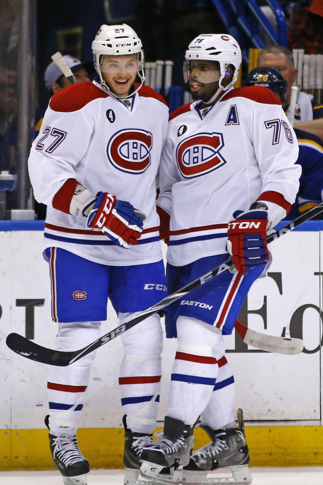 Montreal Canadiens' Alex Galchenyuk, left, is congratulated by teammate P.K. Subban, right, after scoring a goal against the St. Louis Blues during the first period of an NHL hockey game Tuesday, Feb. 24, 2015, in St. Louis. (AP Photo/Billy Hurst)