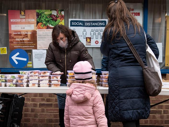 <p>Shirley Ballas, head judge on Strictly Come Dancing, distributes food to people in North West London as part of our campaign</p> (Lucy Young)