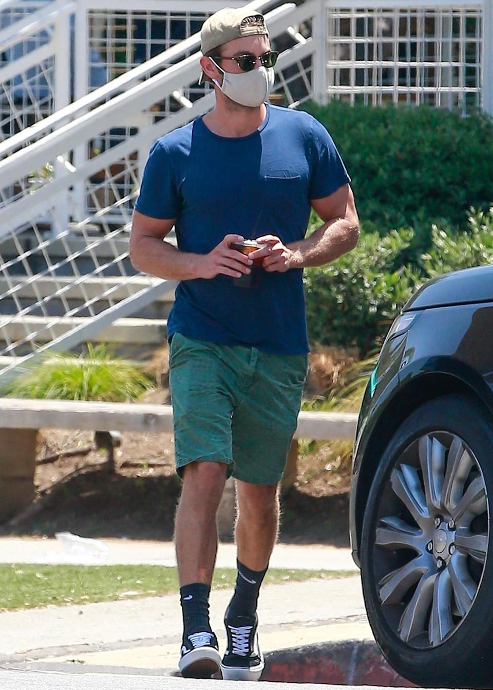 <p>A masked Chace Crawford runs errands on Friday in Los Angeles. </p>