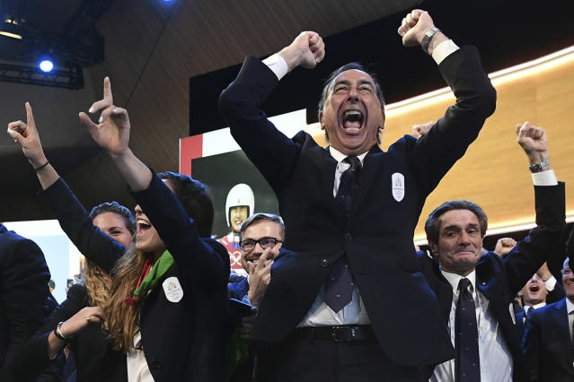 Mayor of Milan Giuseppe Sala and members of Milan-Cortina delegation celebrate after winning the bid to host the 2026 Winter Olympic Games, during the first day of the 134th Session of the International Olympic Committee (IOC), at the SwissTech Convention Centre, in Lausanne, Switzerland, Monday, June 24, 2019. Italy will host the 2026 Olympics in Milan and Cortina d'Ampezzo, taking the Winter Games to the Alpine country for the second time in 20 years. (Philippe Lopez/Pool via AP)