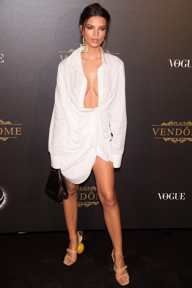 <p>On us, we fear this plunging white Jacquemus dress would look like we'd raided our dad's shirt cupboard. But when Emily wore it to the Paris Fashion Week <em>Vogue</em> party, she looked sensational. [Photo: Getty] </p>