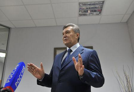 Ukraine's former President Viktor Yanukovich talks to the media after a video link with a Ukrainian court during the trial of former riot police force members, suspected of killing participants of the 2014 anti-government and pro-European Union mass protests, inside a building of a regional court in Rostov-on-Don, Russia, November 25, 2016. REUTERS/Stringer