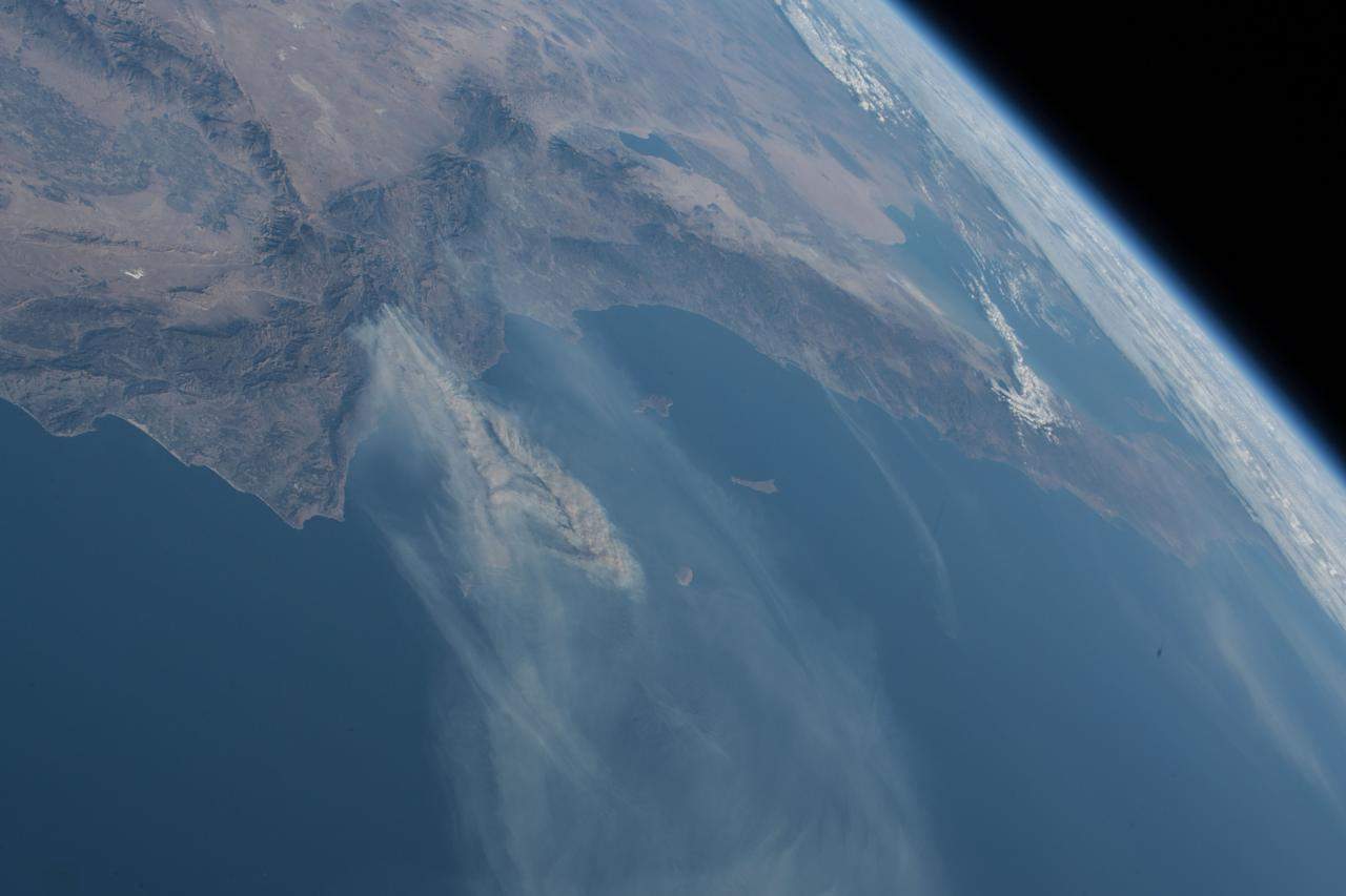 <p>Expedition 53 Commander Randy Bresnik aboard the International Space Station took this photo of the California wildfires in the Los Angeles on Dec. 6, 2017. (Photo: NASA) </p>