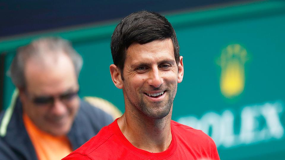 Pictured here, Novak Djokovic has a laugh during preparation for the ATP Cup in Melbourne.