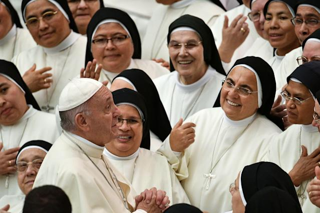 <p>Pope Francis meets with nuns during his weekly general audience in Paul VI hall on August 22, 2018 at The Vatican. (Photo by VINCENZO PINTO/AFP/Getty Images) </p>