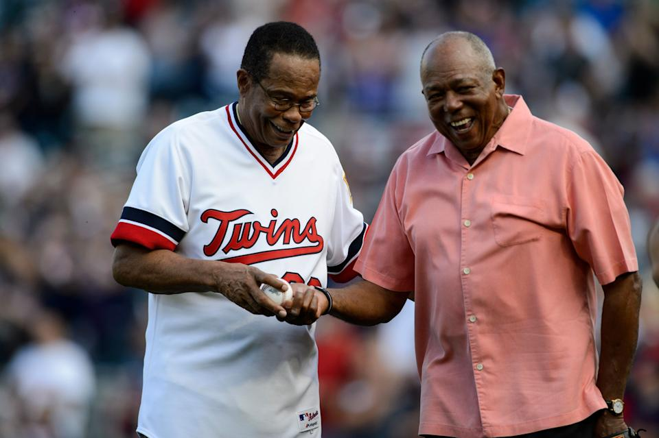 MINNEAPOLIS, MN - JULY 03: Hall of Fame player Rod Carew is handed the ball from his ceremonial pitch from former teammate Tony Oliva as he is honored in a ceremony before the game between the Minnesota Twins and the Los Angeles Angels of Anaheim on July 3, 2017 at Target Field in Minneapolis, Minnesota. The Twins defeated the Angels 9-5. (Photo by Hannah Foslien/Getty Images)