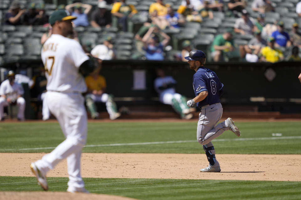 Tampa Bay Rays' Brandon Lowe (8) rounds the bases after hitting a two-run home run off Oakland Athletics starting pitcher Frankie Montas (47) during the sixth inning of a baseball game Saturday, May 8, 2021, in Oakland, Calif. (AP Photo/Tony Avelar)