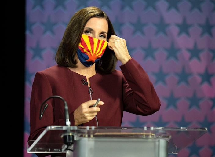 U.S. Sen. Martha McSally, R-Ariz. removes her mask as she prepares to debate Democratic challenger Mark Kelly at the Walter Cronkite School of Journalism at Arizona State University on Oct. 6, 2020.