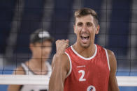 Oleg Stoyanovskiy, of the Russian Olympic Committee, reacts to a play during a men's beach volleyball quarterfinal match against Germany at the 2020 Summer Olympics, Wednesday, Aug. 4, 2021, in Tokyo, Japan. (AP Photo/Felipe Dana)