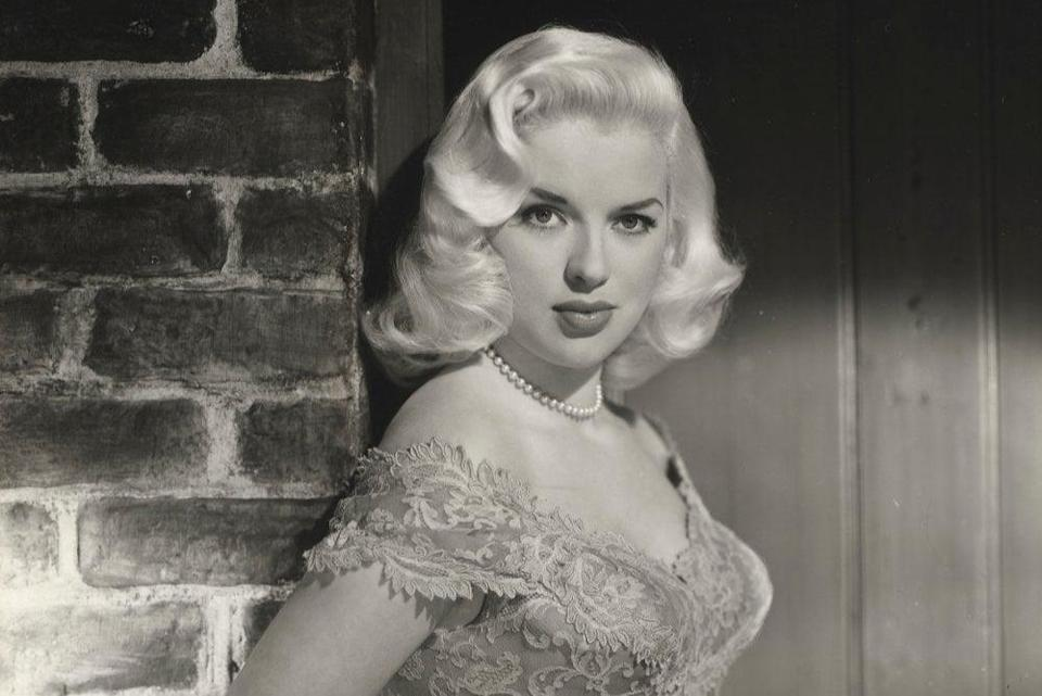 Diana Dors pictured at home
