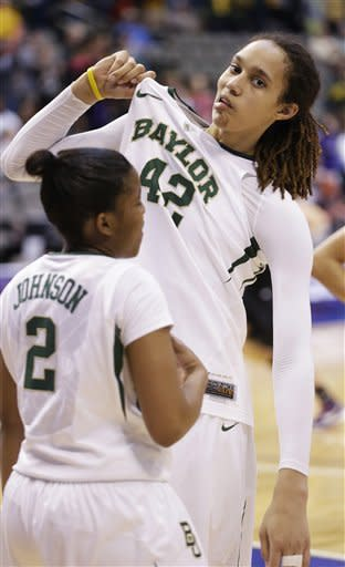 Baylor's Brittney Griner (42) jokes around and pulls her jersey with teammate Niya Johnson (2) looking on during the second half of an NCAA college basketball game Kansas State in the Big 12 Conference tournament Saturday March 9, 2013, in Dallas. Baylor won 80-47. (AP Photo/LM Otero)