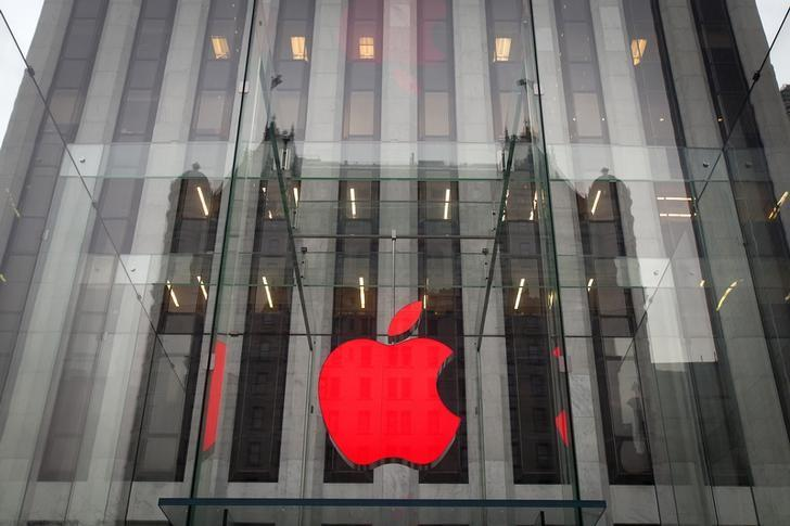 The Apple logo is illuminated in red at the Apple Store on 5th Avenue to mark World AIDS Day, in the Manhattan borough of New York