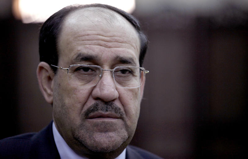 Iraq's Prime Minister Nouri al-Maliki listens during an interview with The Associated Press in Baghdad, Iraq, Wednesday, Feb. 27, 2013. Al-Maliki warns that a victory for rebels fighting to overthrow the Syrian President Bashar Assad would spark a sectarian war in his own country and Lebanon, and create a new haven for extremists that would destabilize the wider Middle East. (AP Photo/ Khalid Mohammed)