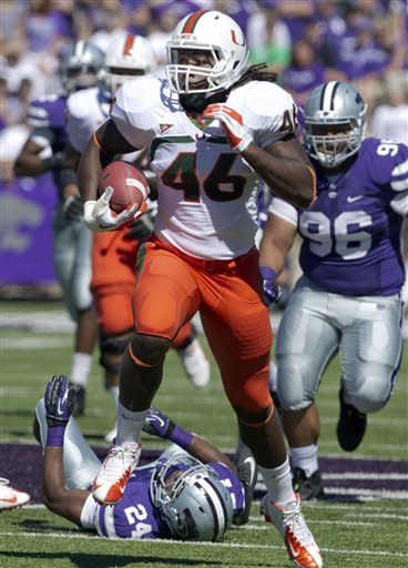 Miami tight end Clive Walford (46) breaks away from Kansas State defensive back Nigel Malone (24) during the first half of an NCAA football game in Manhattan, Kan., Saturday, Sept. 8, 2012. (AP Photo/Orlin Wagner)