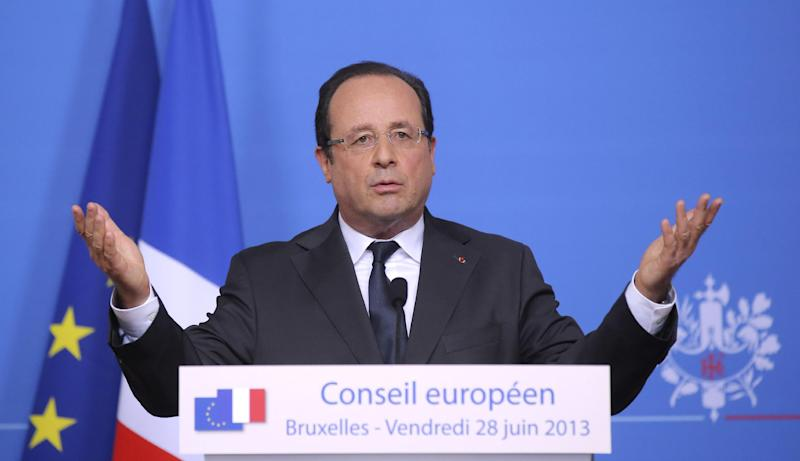 French President Francois Hollande gestures while speaking during a media conference at an EU summit in Brussels on Friday, June 28, 2013. After late night budget talks, European Union leaders are turning their attention away from their financial troubles Friday and toward embracing once-troubled Balkan countries. (AP Photo/Michel Euler)