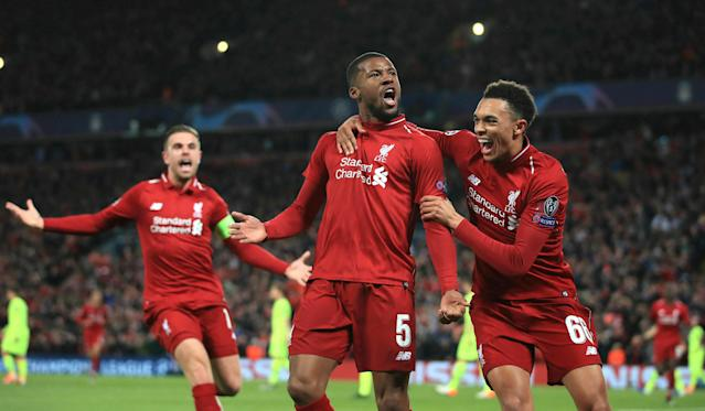 Liverpool's Georginio Wijnaldum (C) celebrates scoring his side's third goal of the game during the Champions League semifinal, second leg soccer match between Liverpool and Barcelona at Anfield, Liverpool, England, Tuesday, May 7, 2019. (AP)