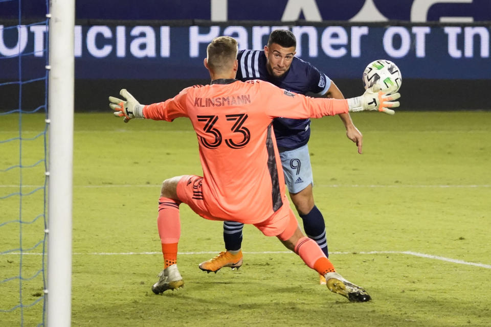 Los Angeles Galaxy goalkeeper Jonathan Klinsmann (33) stops a shot from Vancouver Whitecaps's Lucas Cavallini during the second half of an MLS soccer match, Sunday, Oct. 18, 2020, in Carson, Calif. (AP Photo/Marcio Jose Sanchez)
