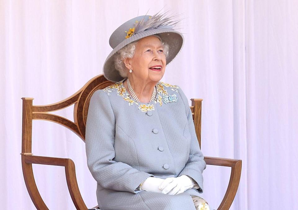 <p>The Queen watching the Trooping Colour ceremony in Windsor. </p>