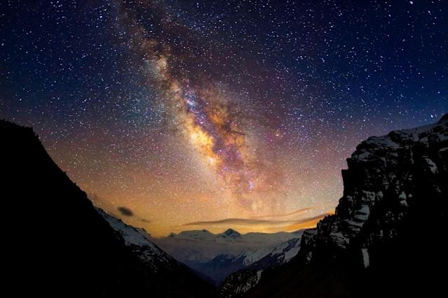 PIC BY ANTON JANKOVOY / CATERS NEWS - (PICTURED: A Himalayan night scape) - A starry-eyed photographer has captured the beauty of a Himalayan night sky after spending months at the foot of the highest mountain in the world. Dedicated photographer, Anton Jankovoy, spent months camping at the foot of Mount Everest in a bid to capture the perfect picture. Now the 23-year-old, who dedicated three years to the project, has caught a series of stunning night shots on camera from star trails and meteors to the milky way and moon rise. The majestic images which took hours to capture and expose, capture the natural beauty of the nights sky. SEE CATERS COPY. ** NOT FOR SALE IN POLAND OR RUSSIA **