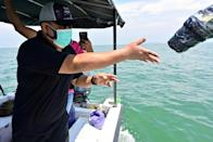 Scientists in Indonesia are using plastic monitoring devices with satellite beacons to monitor the flow of waste in the sea