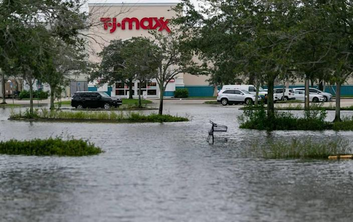 A flooded parking lot can be seen near T.J. Maxx in Sawgrass Mills Mall in Sunrise on Monday, Nov. 9, 2020. Tropical Storm Eta made its way past South Florida Sunday night, leaving roads and neighborhoods flooded.