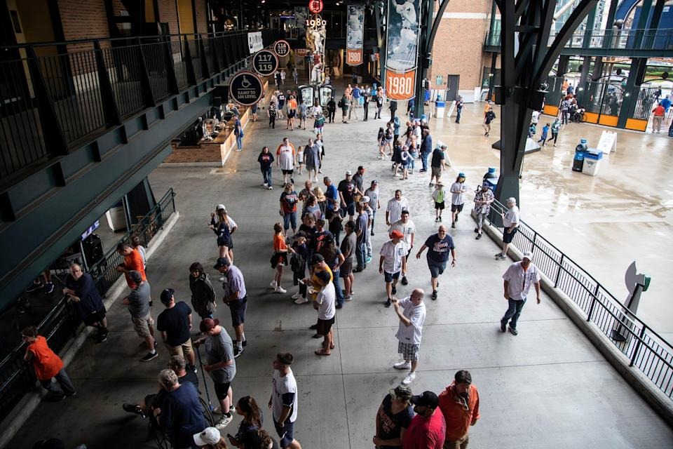 Baseball fans walk around Comerica Park before a Tigers game against Seattle Mariners at Comerica Park in Detroit, Tuesday, June 8, 2021.