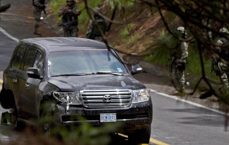 ALTERNATIVE CROP OF MXAM103.- An armored U.S. Embassy vehicle is seen riddled with bullets, most concentrated around the passenger-side window, after it was attacked by unknown assailants on the highway leading to the city of Cuernavaca, near Tres Marias, Mexico, Friday, Aug. 24, 2012. Two U.S. government employees were shot and wounded in an attack on their vehicle south of Mexico City on Friday, a law enforcement official said. (AP Photo/Alexandre Meneghini)