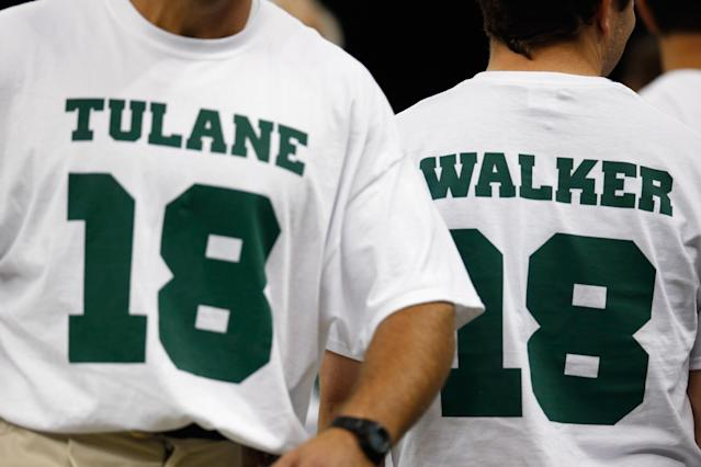 Members of the Tulane Green Wave football team wear the number 18 showing support for injured player Devon Walker at the Louisiana Superdome on September 22, 2012 in New Orleans, Louisiana. (Photo by Chris Graythen/Getty Images)