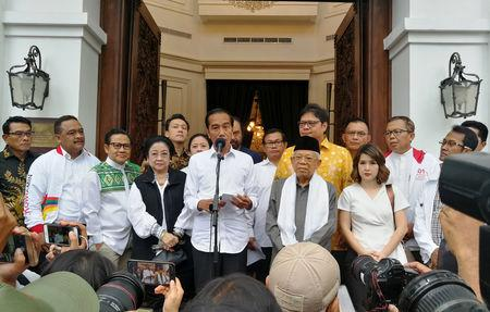 Incumbent Indonesian president Joko Widodo talks to media during a press briefing in Jakarta