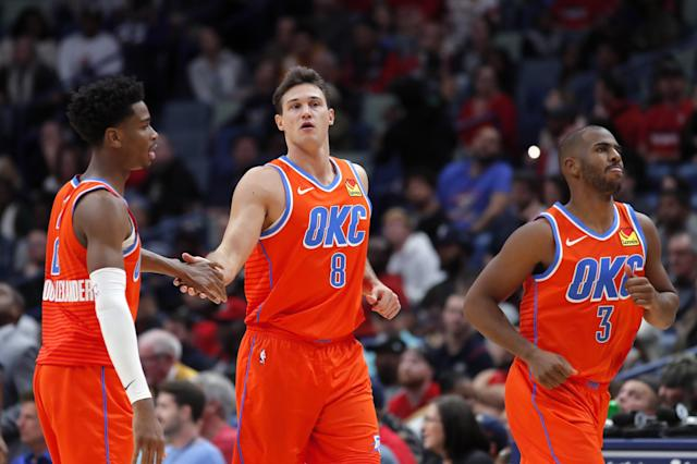 Oklahoma City Thunder forward Danilo Gallinari (8) celebrates a three-point basket with guards Shai Gilgeous-Alexander and Chris Paul (3) in the second half of an NBA basketball game against the New Orleans Pelicans in New Orleans, Sunday, Dec. 1, 2019. (AP Photo/Gerald Herbert)
