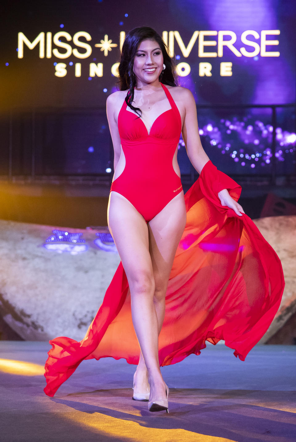 Lynette Chua competing in the swimwear segment during the 2019 Miss Universe Singapore at Zouk.